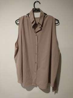 Slit collar sleeveless blouse