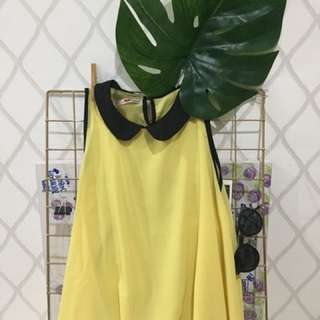 Yellow top with black collar