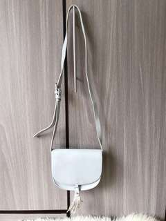 Gray sling bag with tassels