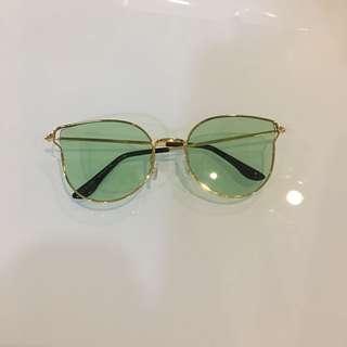 Green lens sunnies
