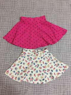 A pair of Fox kids' skirts (size 8 and 10)