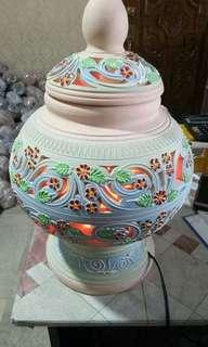himalayan salt lamp in clay pot