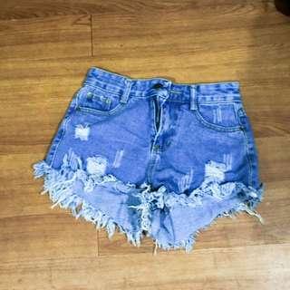 High waist tattered denim shorts