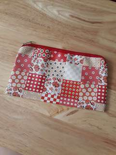 Red floral patchwork pouch