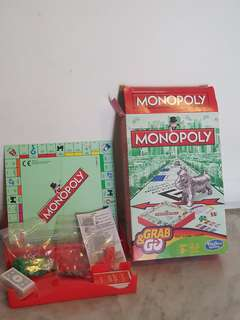Brand new never-used Monopoly Grab & Go set