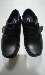 New black shoes for kids