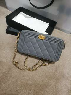 Chanel wallet on chin