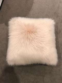 Pink fur cushion