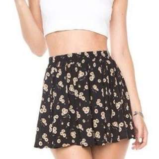 brandy melville luma skirt in black sunflower floral