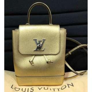 LOUIS VUITTON gold leather mini lockme backpack bag (2017)
