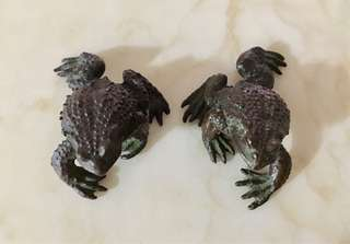 A pair of handmade solid copper toad figurines