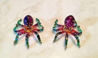 A pair of handmade, coloured glass octopus