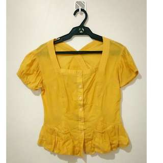 Yellow-orange comfortable top with garterized sleeves, bust, and pockets