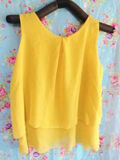 Yellow top sleeveless