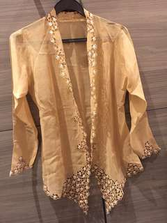 Vintage Kebaya light brown with very fine workmanship.
