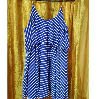 blue and white striped sleeveless top