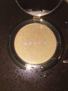 Becca topaz flashes gilt highlighter