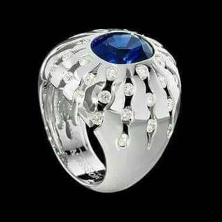 Platinum ring with blue sapphire and diamonds