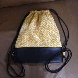 Yellow draw strings bag