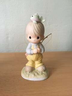 Precious Moments Figurine (Caught Up In...)