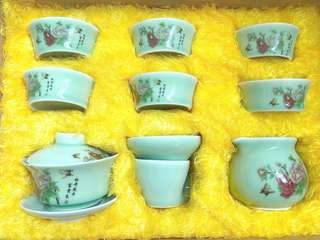 Antique China tea set with goldfish in the cup