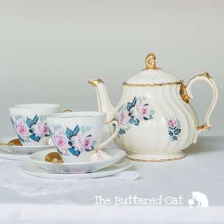 Pretty tea-for-two comprising of a vintage Sadler teapot and two English bone china trios in matching pattern