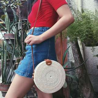 White rattan bag with brown leather closure and inner lining