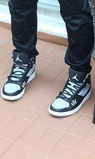 Black and grey jordans