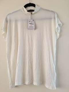 Zara closed-neck blouse cream color