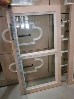 Used kitchen cabinet windows 8 pieces available (4 pairs )