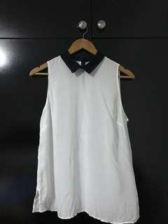 White top with black Peter Pan collar