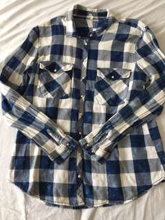 STRADIVARIUS: CHECKERED BLUE AND WHITE LONG SLEEVED POLO