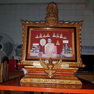 Wooden photo frame with buddha amulets