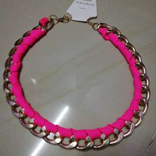 Gold choker with pink braid