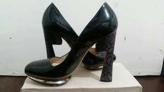 high heeled black shoes
