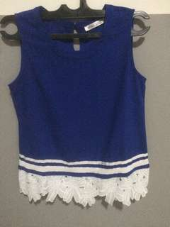 Electric blue Sleeveless top. Floral detail.