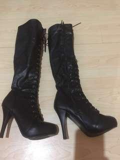 black leatherette lace up boots.