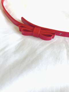 Red belt with bow