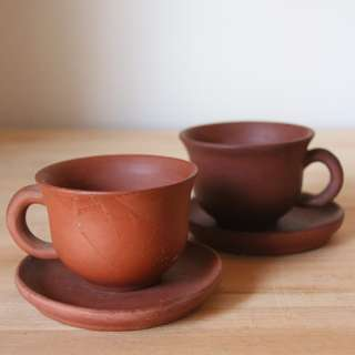 Chinese clay teacups with saucers
