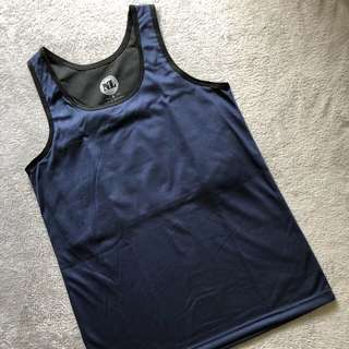 Singlet with chest binder