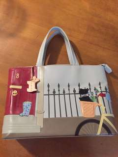 Radley signature handbag dog with a bicycle