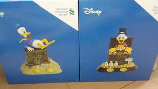 Standard chartered donald duck and uncle scrooge piggy bank money bank