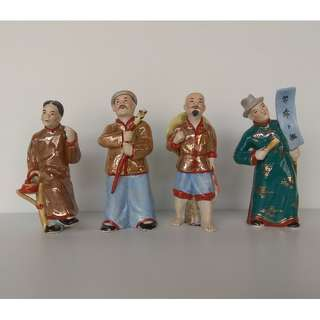 One set of 4 pieces Vintage Sculpture Porcelain Chinese Figurines: Busker, Candied haws seller, Fortune teller And Fisherman