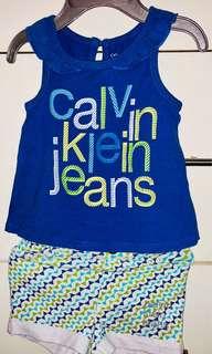 Calvin Klein shirt and shorts