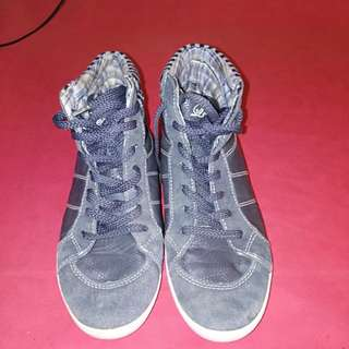 Dirty gray rubber shoes