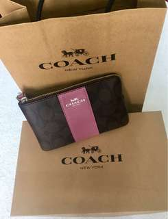 COACH F58035 CORNER ZIP WRISTLET IN SIGNATURE COATED CANVAS WITH LEATHER STRIPE [Khaki/Pink] (Imported from USA, Genuine)