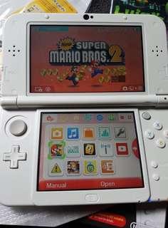 Nintendo 3dsXL (pearl white) + 2 games
