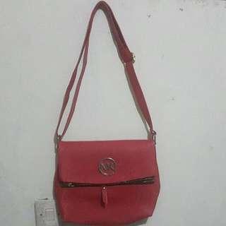 MK red sling bag