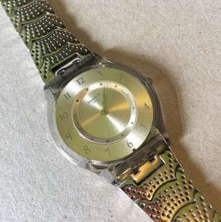 Metal thin Swatch watch for ladies - scallop design