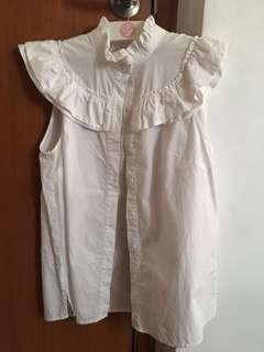 White HnM top with ruffles